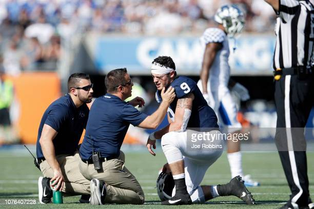 Trace McSorley of the Penn State Nittany Lions is checked out after suffering an injury against the Kentucky Wildcats in the second quarter of the...