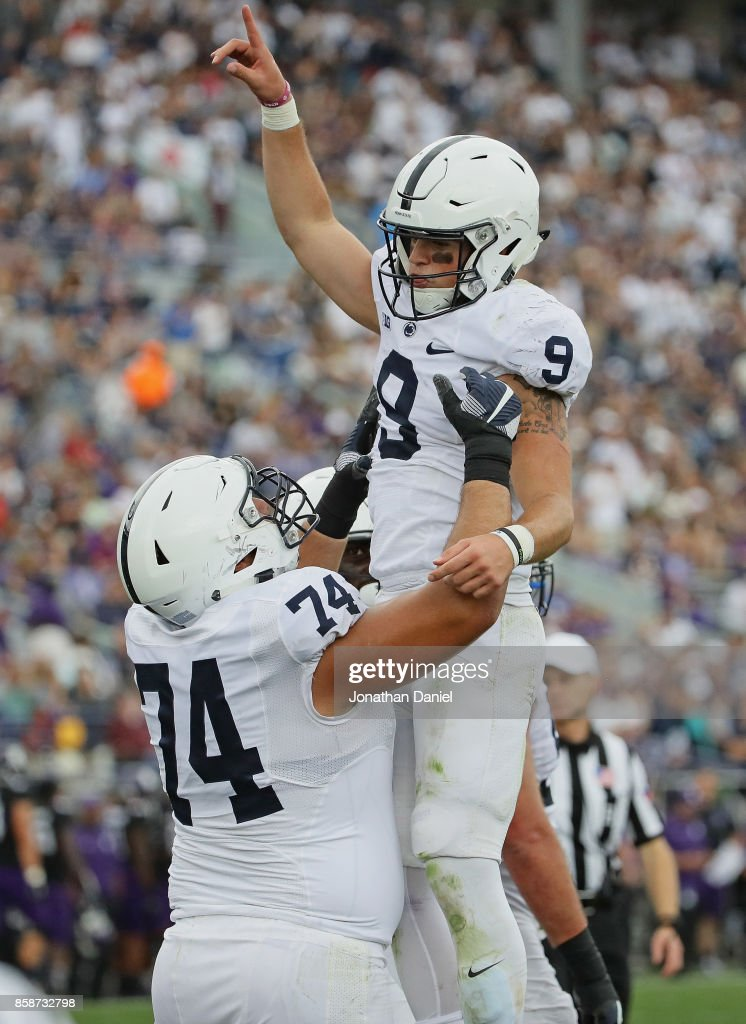 Trace McSorley #9 of the Penn State Nittany Lions is lifted by teammate Steven Gonzalez #74 after scoring a touchdown against the Northwestern Wildcats at Ryan Field on October 7, 2017 in Evanston, Illinois. Penn State defeated Northwestern 31-7.
