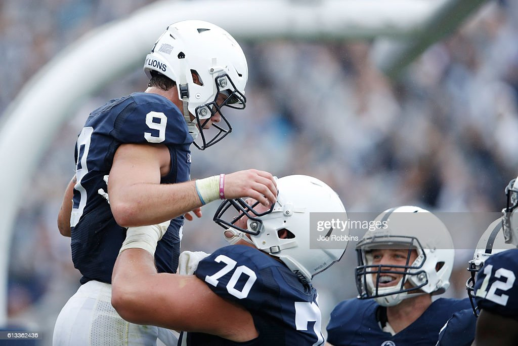 Trace McSorley #9 of the Penn State Nittany Lions is lifted up by Brendan Mahon #70 after rushing for a nine-yard touchdown in the second quarter against the Maryland Terrapins at Beaver Stadium on October 8, 2016 in State College, Pennsylvania.