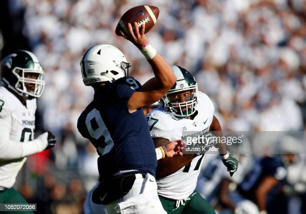 Trace McSorley of the Penn State Nittany Lions is pressured by Tyriq Thompson of the Michigan State Spartans on October 13 2018 at Beaver Stadium in...