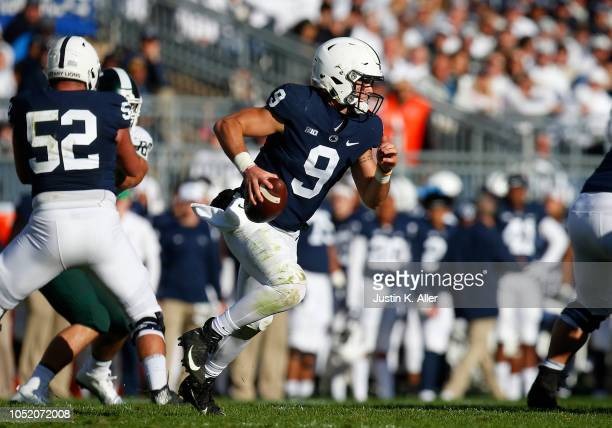 Trace McSorley of the Penn State Nittany Lions rushes against the Michigan State Spartans on October 13 2018 at Beaver Stadium in State College...