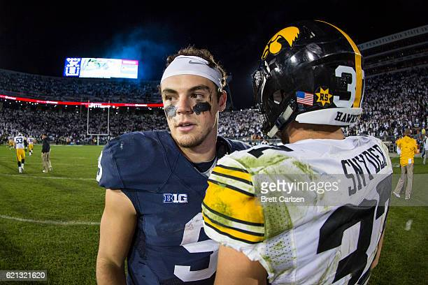 Trace McSorley of the Penn State Nittany Lions speaks with Brandon Snyder of the Iowa Hawkeyes after the game on November 5 2016 at Beaver Stadium in...