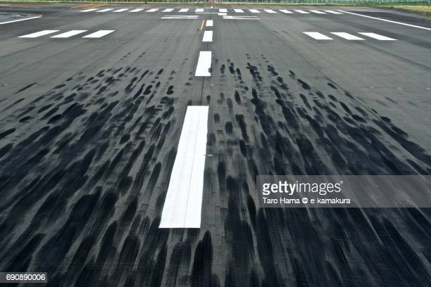 Trace of airplane tires on runway in Osaka International Airport