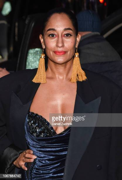 Tracee Ellis Ross is seen wearing a black jacket and Versace dress outside the Versace PreFall 2019 Collection on December 2 2018 in New York City