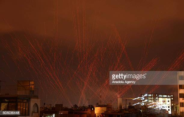 Tracer bullets fired by Assad Regime Forces light the sky to celebrate New Year in Damascus Syria on January 01 2016