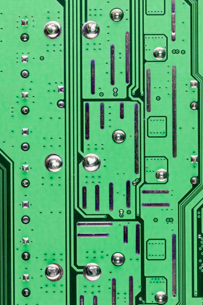 Traces and vias on a computer circuit board photographed close up, United Kingdom