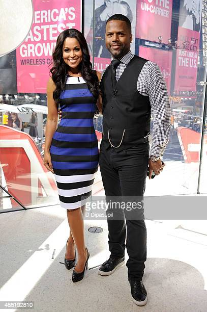 "Tracey Edmonds and AJ Calloway pose on the set of ""Extra"" at their New York studios at H&M in Times Square on September 14, 2015 in New York City."