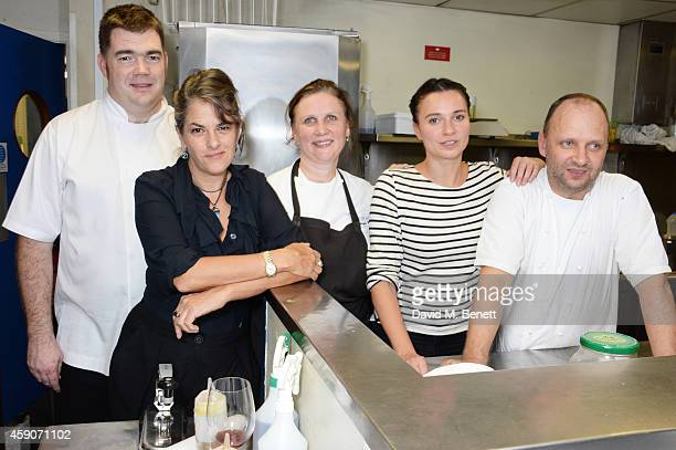 Tracey Emin poses with chefs Nathan Outlaw Angela Hartnett Gizzi Erskine and Simon Rogan pose in the kitchen at the Fine Wine Auction Dinner hosted...