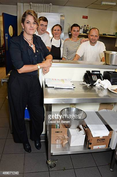 Tracey Emin poses with chefs Nathan Outlaw Angela Hartnett Gizzi Erskine and Simon Rogan in the kitchen at the Fine Wine Auction Dinner hosted by...