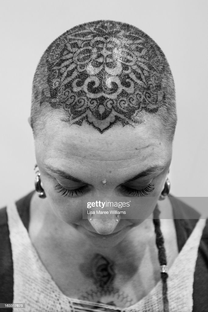 Tracey from 'Skintastic' shows off her new head tattoo by artist Anthony Orsatti during The Australian Tattoo & Body Art Expo at the Royal Hall of Industries, Moore Park on March 8, 2013 in Sydney, Australia. The annual three day event showcases some of Australia's best tattoo and body artists and is open to enthusiasts March 8-10.