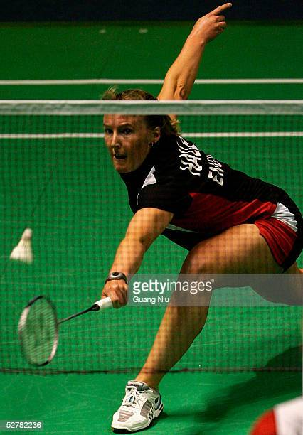 Tracey Hallam of England returns a shot during the 2005 Sudirman Cup World Mixed Team Badminton Championships against Tine Rasmussen of Denmark at...