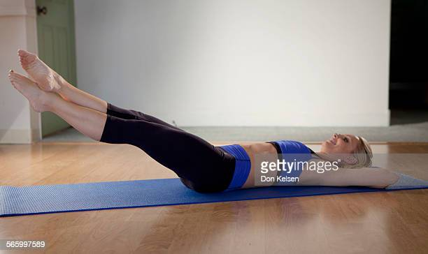 – – Tracey Mallett demonstrates the Frog pelvic tilt PHOTOGRAPHED TUESDAY FEBRUARY 28 2012