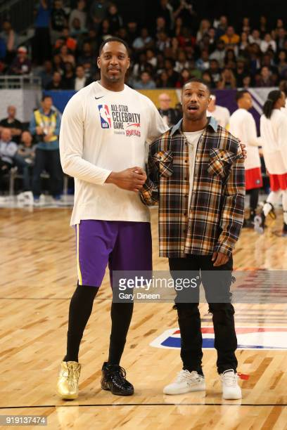Tracey McGrady and Michael B Jordan talk during the NBA AllStar Celebrity Game presented by Ruffles as a part of 2018 NBA AllStar Weekend at the Los...