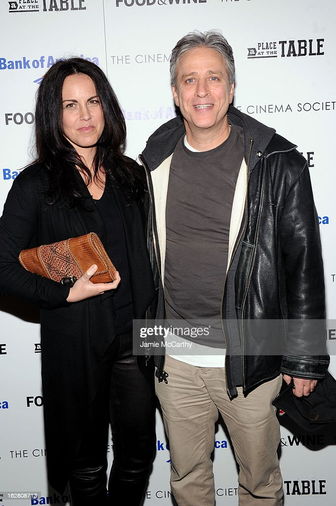 Tracey McShane and Jon Stewart attend the Bank of America and Food & Wine with The Cinema Society screening of 'A Place at the Table' at Museum of Modern Art on February 27, 2013 in New York City.