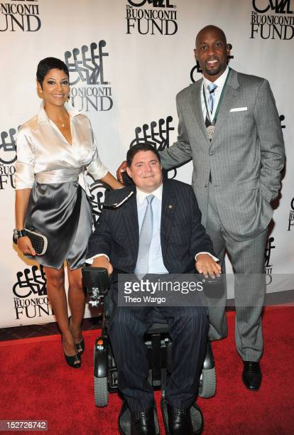 Tracey Mourning Marc Buoniconti and former NBA basketball player Alonzo Mourning attends the 27th Annual Great Sports Legends Dinner to benefit the...