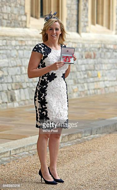 Tracey Neville Head Coach of the England Netball Squad poses after receiving her Member of the Order of the British Empire medal by Princess Royal at...