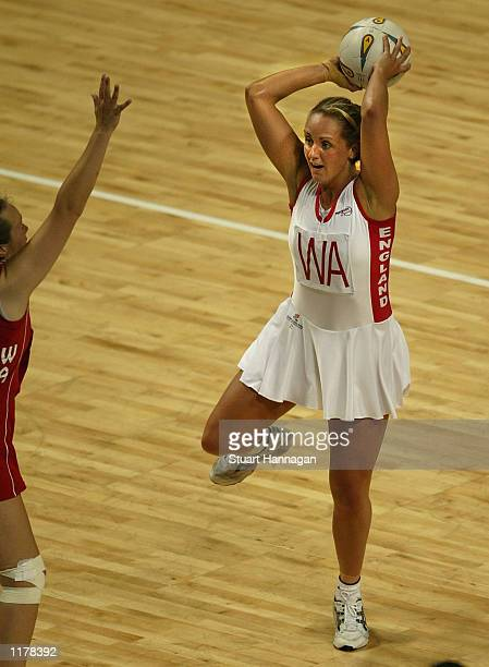 Tracey Neville of England passes off the ball in the match between England and Wales at the Men Arena during the 2002 Commonwealth Games in...