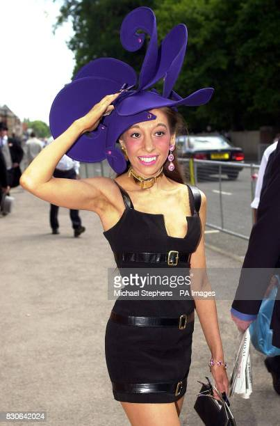 Tracey Rose from London arriving for the second day of Ascot Wednesday June 20 2001 wearing a flamboyant electric blue hat pink jewel earrings and a...