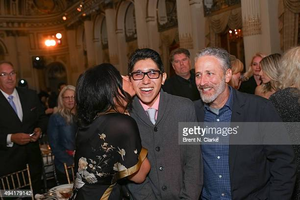 Tracey Stewart gives Bruno Barba a kiss as Jon Stewart looks on during the 2015 Farm Sanctuary Gala held at The Plaza Hotel on October 24 2015 in New...