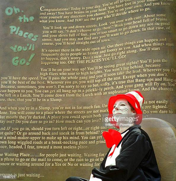 Tracey Thompson dreesed as the Cat in the Hat listens to speakers during the opening of the Dr Suess Memorial Sculpture Garden May 31 2001 in...