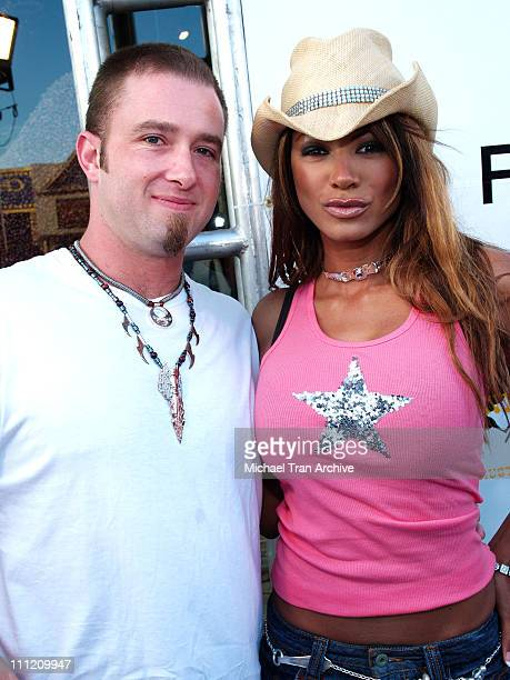 Traci Bingham and Jeff during Flaunt Magazine Presents The Premiere Party of Antik Denim's Signature Store - August 18, 2005 at Antik Signature Store...