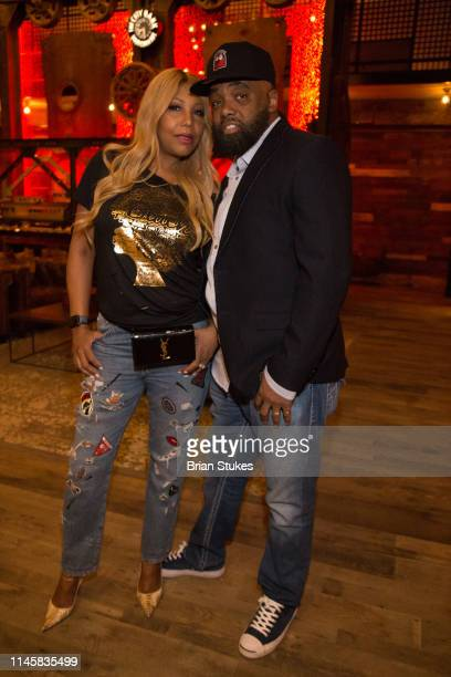 "Traci Braxton and Kevin Surrat attend ""Real Housewives Of Potomac"" Premiere Party at The Hecht Warehouse at Ivy City on April 28, 2019 in Washington,..."