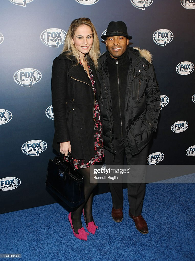 Traci Lynn Johnson and Tiki Barber attends the 2013 Fox Sports Media Group Upfront after party at Roseland Ballroom on March 5, 2013 in New York City.