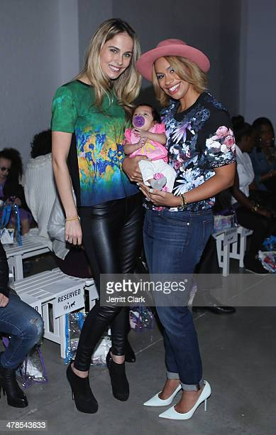 Traci Lynn Johnson poses with her daughter Brooklyn and Amber Sabathia at the CCandy Clothing fashion show at the Petite Parade Kids Fashion Show at...