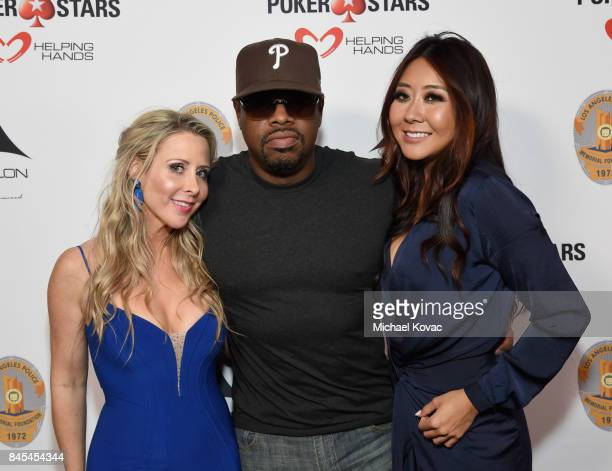 Traci Szymanski musician Nathan Cross and pro Poker player Maria Ho at the Heroes for Heroes Los Angeles Police Memorial Foundation Celebrity Poker...