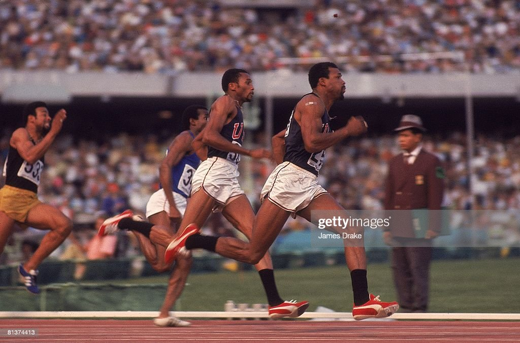 1968 Summer Olympics, USA Tommie Smith and John Carlos in action during 200M competition, Mexico City, MEX
