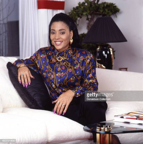 Track and field athlete Florence Griffith Joyner poses for a portrait at home for a portrait session in circa 1988 in Los Angeles California