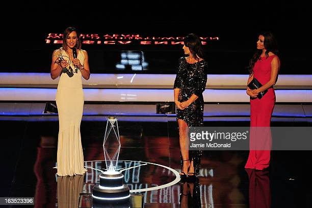 Track and field athlete Jessica Ennis receives her award for Laureus Sportswomen of the Year as presenters Laureus Academy Member Nadia Comaneci and...