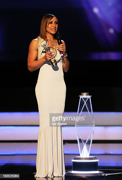 Track and field athlete Jessica Ennis receives her award for 'Laureus Sportswomen of the Year' on stage during the awards show for the 2013 Laureus...