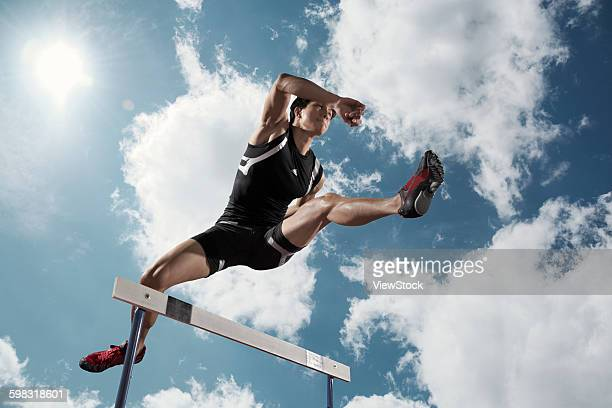 track and field athletes in hurdle race - hurdling track event stock pictures, royalty-free photos & images