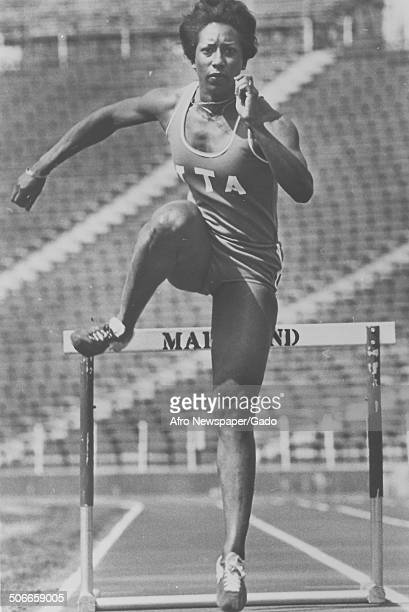 Track and field athletes leaping over hurdles at the University of Maryland College Park College Park Maryland 1980