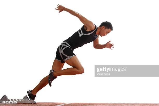 Track and field athletes running