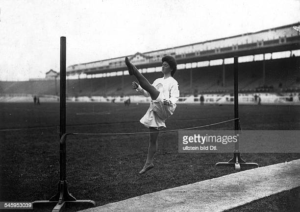 Track and field athletics women high jump a Swedish athlete jumps across a rope in the background the empty seats of the White City Stadium in London