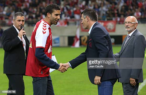 Track and field champion born in Reims Mahiedine Mekhissi is congratulated by head coach of Bordeaux Willy Sagnol after kicking off the French Ligue...