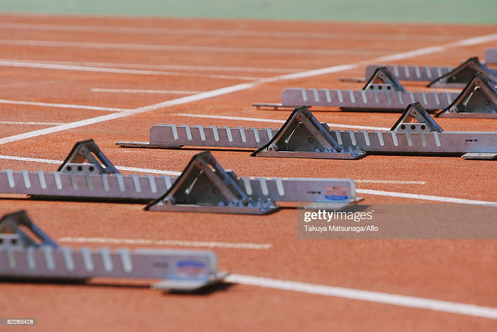 Track and field starting blocks at starting line : Stock Photo