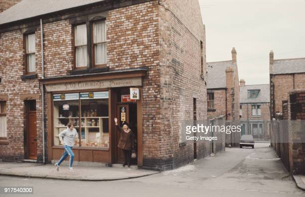 Track Athlete Brendan Foster pictured running past a corner shop during a training run circa 1977 in Gateshead England