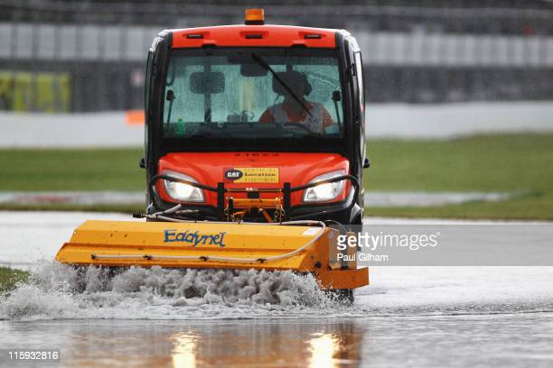 Track cleaning vehicle tries to clear the water from the circuit during the Canadian Formula One Grand Prix at the Circuit Gilles Villeneuve on June...