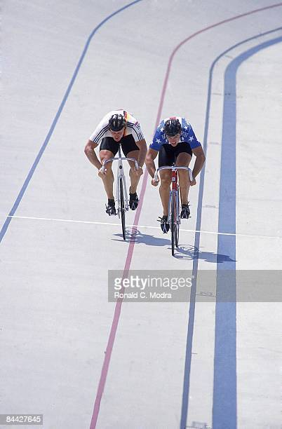 1984 Summer Olympics USA Mark Gorski in action passing West Germany Gerhard Scheller during Men's 1000M Sprint at Olympic Velodrome on Cal State...