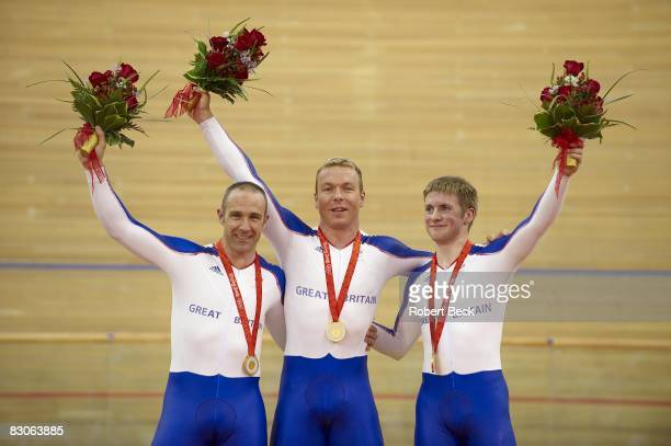 2008 Summer Olympics Great Britain Jamie Staff Chris Hoy Jason Kenny victorious with gold medals after Men's Team Sprint Final at Laoshan Velodrome...