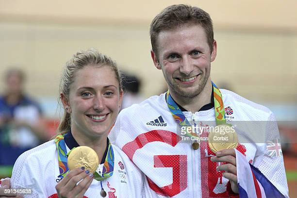 Day 11 Jason Kenny of Great Britain and his fiancee Laura Trott show their gold medals after both winning gold on the same day during the track...