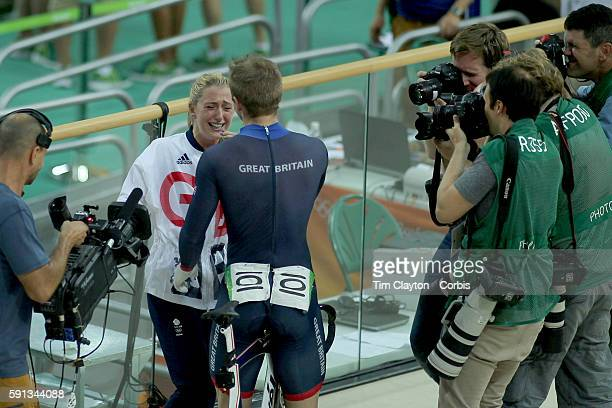 Day 11 Jason Kenny of Great Britain is met by his fiancee Laura Trott after his gold medal ride in the Men's Keirin during the track cycling...