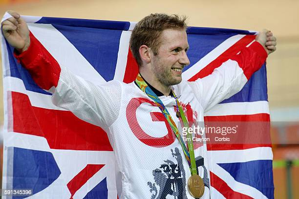 Track Cycling - Olympics: Day 11 Jason Kenny of Great Britain on the podium with his gold medal after his victory in the Men's Keirin during the...