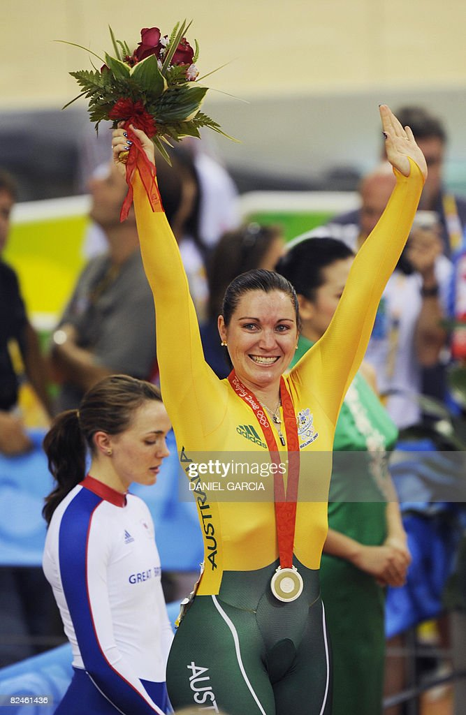 Track cyclist Anna Meares of Australia celebrates on the podium after receiving the silver medal won in the 2008 Beijing Olympic Games women's sprint final at the Laoshan Velodrome in Beijing on August 19, 2008.