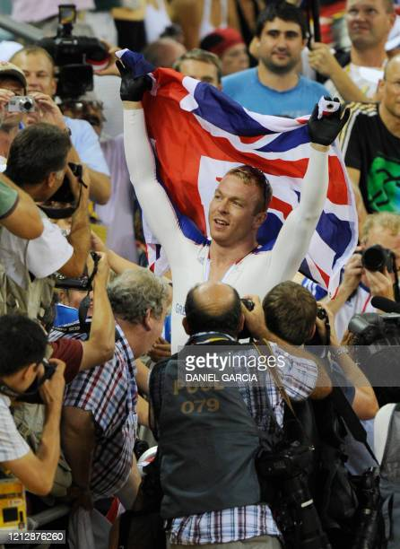 Track cyclist Chris Hoy of Great Britain celebrates after winning the gold medal in the 2008 Beijing Olympic Games men's sprint final at the Laoshan...