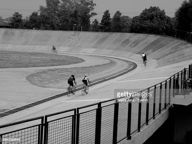 Track Cyclists Riding In Velodrome