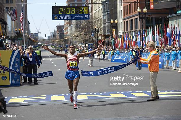 118th Boston Marathon: USA Meb Keflezighi in action and victorious, crossing finish line and winning race on Boylston Street. Boston, MA 4/21/2014...